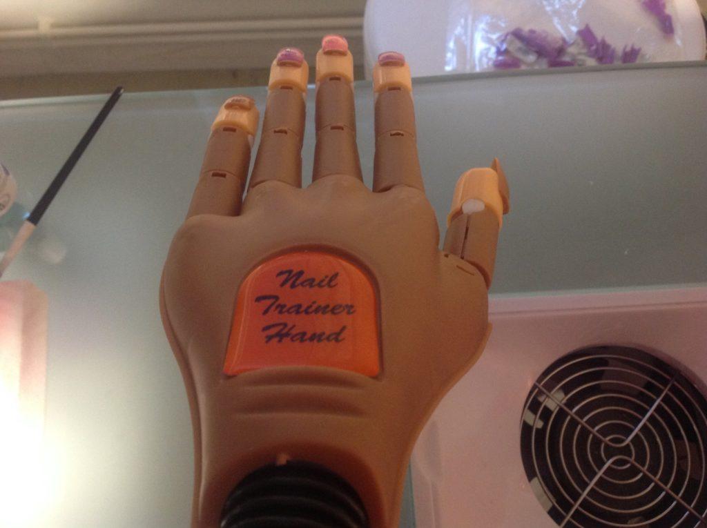 nail trainer hand logo